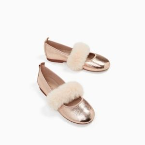 Zara girls golden flats with faux fur detail.